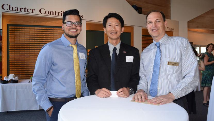 Associate Provost Rich Wilkens with two new faculty members