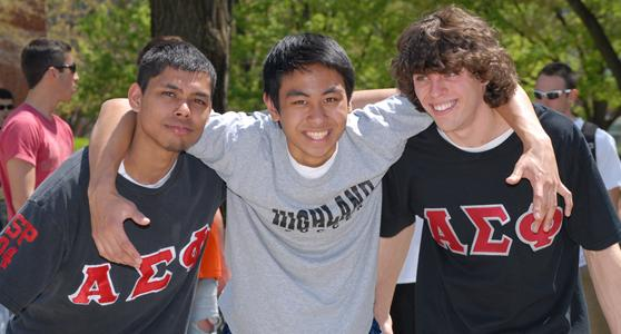 Three Students pose with arms around each other