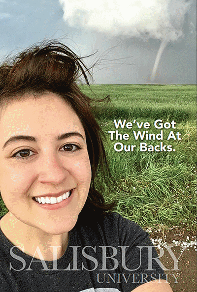"SU Spotlight Cover for 1st edition. SU student stands in field with tornado in background overlay text reads ""We've Got The Wind At Our Backs"""