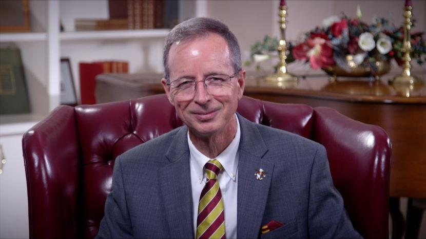 "Screen capture of Dr. Wight. With text ""Welcome Back: A Message from Salisbury University President Charles Wight"""