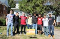 Fraternity students group photo during volunteer work