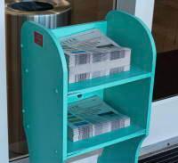 Newspaper stack plastic holder