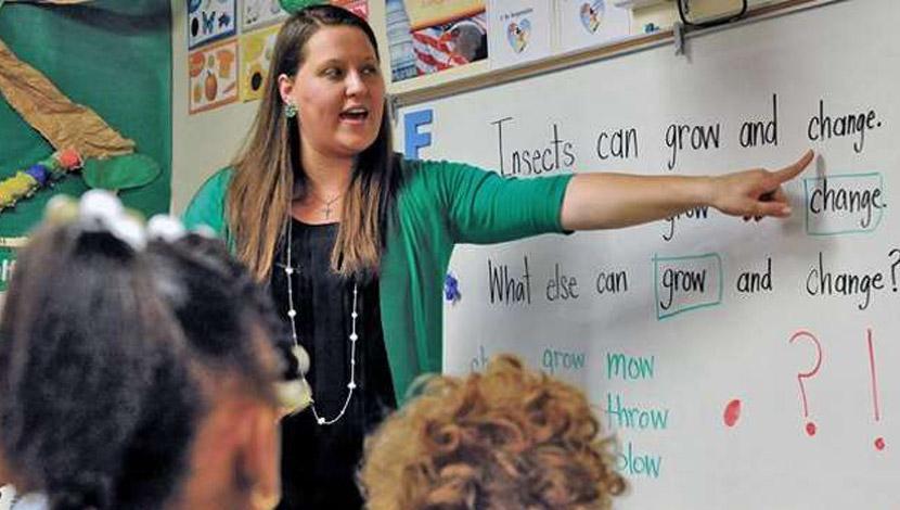 Teacher providing instruction in a classroom