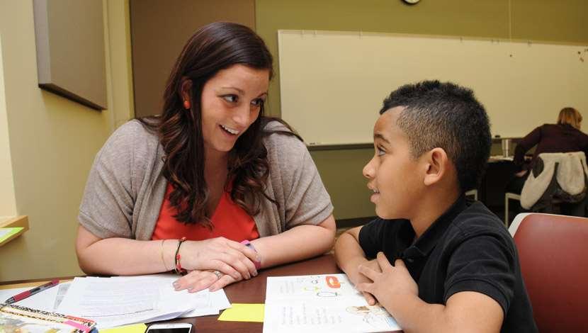Teacher mentoring young student