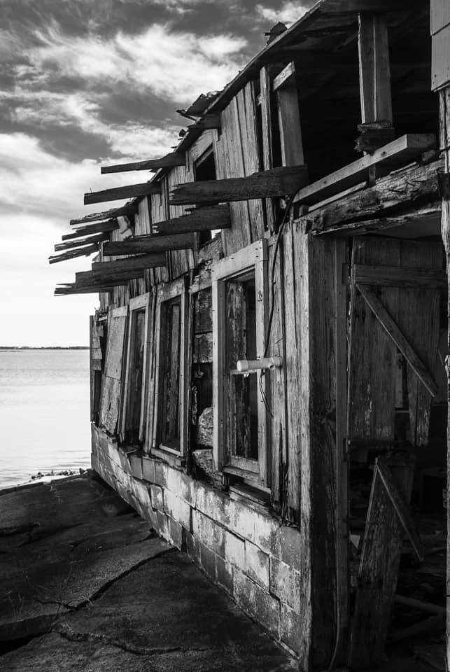 Award winning photograph by Salisbury Student. Showing boat house on the water