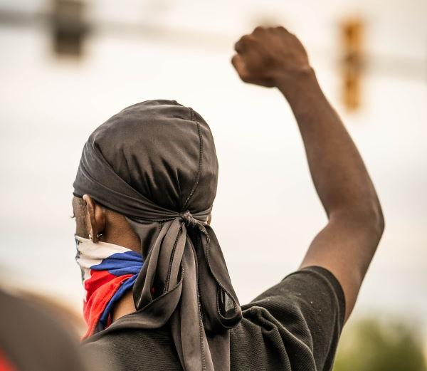 Young man with his fist raised in solidarity