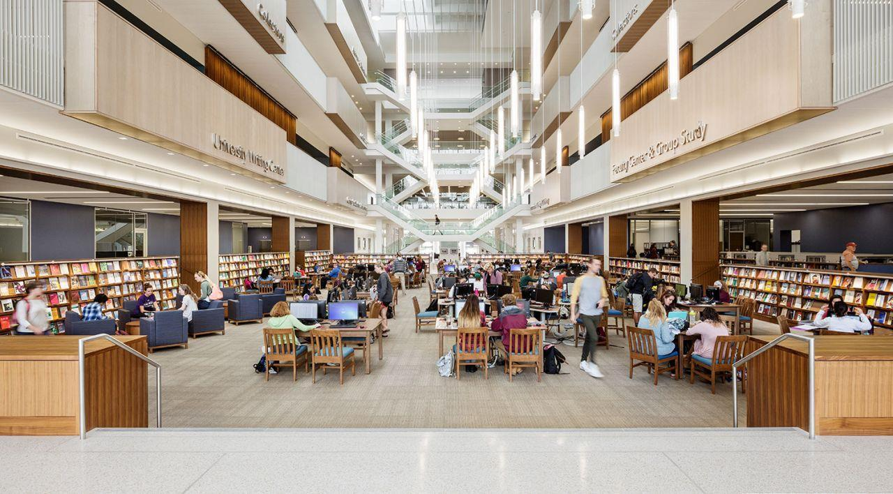 View of the Atrium showing tables and computers with students studying